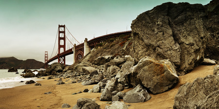 sf: Golden Gate Bridge with rock panorama in San Francisco as the famous landmark.
