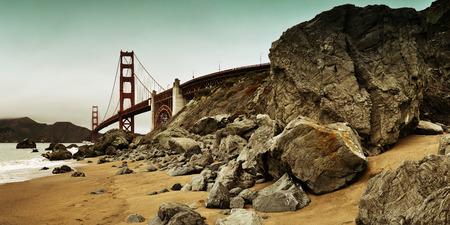san francisco golden gate bridge: Golden Gate Bridge with rock panorama in San Francisco as the famous landmark.
