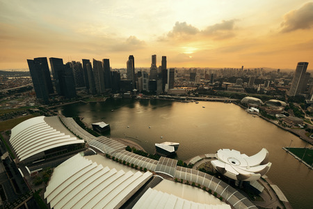 marina bay: Singapore rooftop view of Marina Bay with urban skyscrapers at sunset.