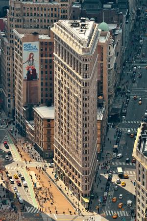 burnham: NEW YORK CITY, NY - DEC 30: Flatiron Building rooftop view on March 30, 2014 in New York City. Flatiron building designed by Chicagos Daniel Burnham was designated a New York City landmark in 1966.