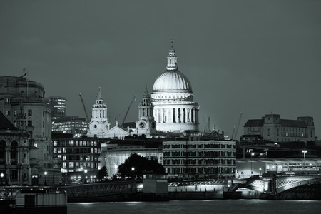 st pauls: St Pauls Cathedral over Thames River at night in London in black and white.