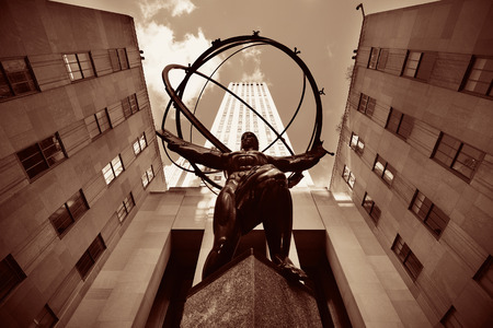 declared: NEW YORK CITY, NY - MAR 30: Rockefeller Plaza Atlas statue on March 30, 2014 in New York City. Declared a National Historic Landmark in 1987, it is a complex of 19 commercial buildings