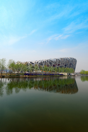 olympics: BEIJING, CHINA - APR 7: Beijing National Stadium with blue sky on April 7, 2013 in Beijing, China. The stadium was established for the 2008 Summer Olympics and Paralympics. Editorial