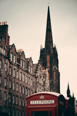 ancient telephone: Edinburgh city street view with telephone box in United Kingdom. Editorial