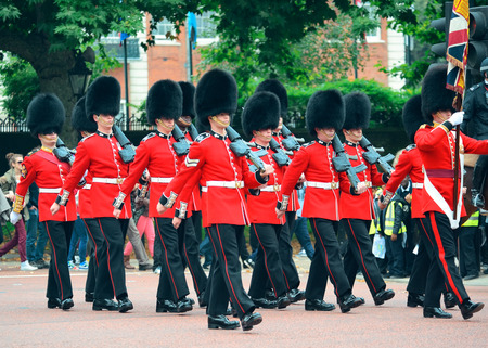 buckingham palace: LONDON, UK - SEP 27: Change of Guard parade on September 27, 2013 in London, UK. The ceremony is one of the top attractions in London and UK military traditions.