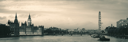 the palace of westminster: Thames River panorama with London Eye and Westminster Palace in black and white in London. Stock Photo