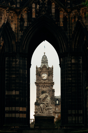 scott: Balmoral Hotel bell tower viewed through Scott Monument in Edinburgh Editorial