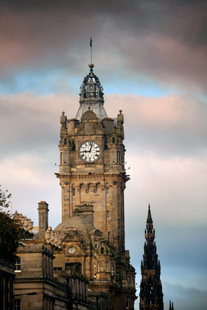 scott: Balmoral Hotel bell tower with Scott Monument and Edinburgh city view. Editorial
