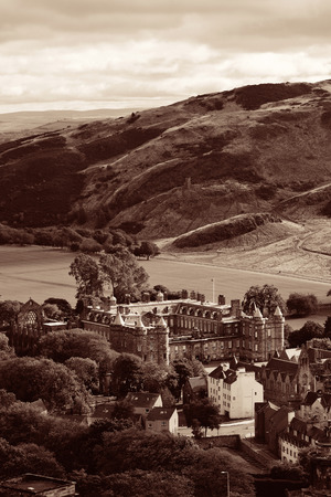 scott monument: Edinburgh city and mountain viewed from Calton Hill. United Kingdom.