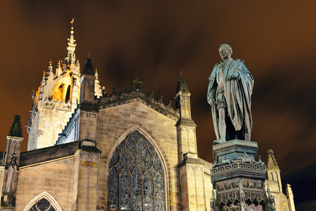 scott: St Giles Cathedral with Duke of Buccleuch (Walter Scott) statue as the famous landmark of Edinburgh. United Kingdom.