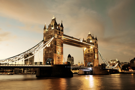 thames: Tower Bridge over Thames River at dusk in London