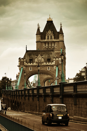 Tower Bridge closeup with vintage taxi in London. Stock Photo