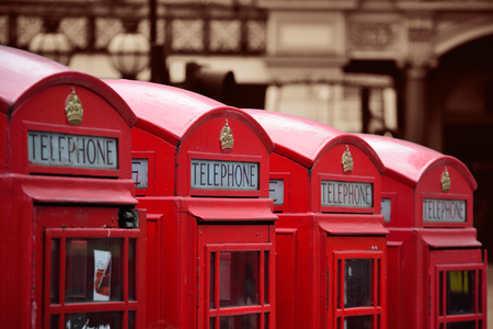 telephone box: Red telephone box in street with historical architecture in London. Stock Photo