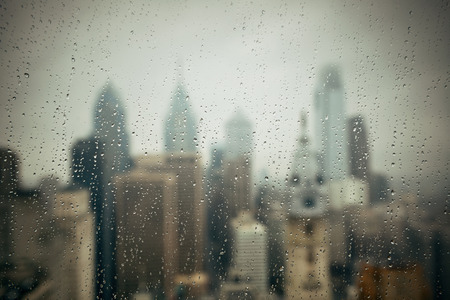 Philadelphia city rooftop view with urban skyscrapers in a raining day.