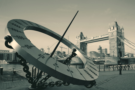 Tower Bridge and sundial over Thames River in London. Stock Photo