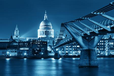 millennium: Millennium Bridge and St Pauls Cathedral at night in London