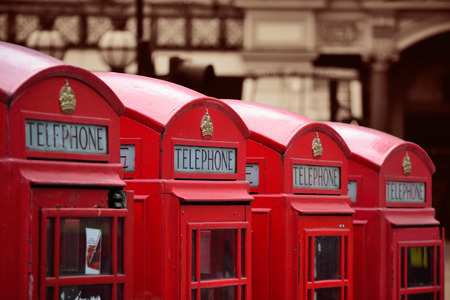 telephone: Red telephone box in street with historical architecture in London. Stock Photo