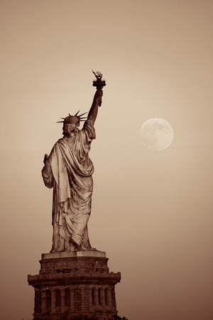 white light: Statue of Liberty and full moon in BW in New York City