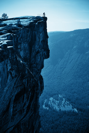 abyss: Hiker look down from Taft Point in Yosemite BW. Stock Photo