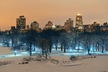 Central Park winter at night with skyscrapers in midtown Manhattan New York City Stock Photo