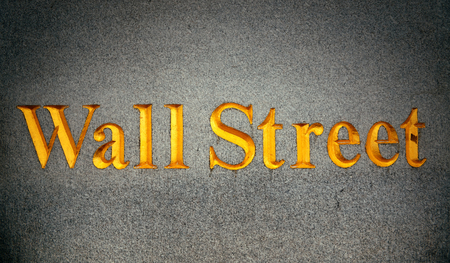 nasdaq: NEW YORK CITY - SEP 5: Wall Street with skyscrapers on September 5, 2014 in Manhattan, New York City. Wall Street financial district, with major exchanges headquarters, has been called the worlds principal financial center. Editorial