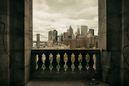 old city: New York City downtown architecture skyline through abandoned balcony. Stock Photo
