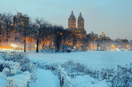 Central Park winter at night with skyscrapers in midtown Manhattan New York City Archivio Fotografico