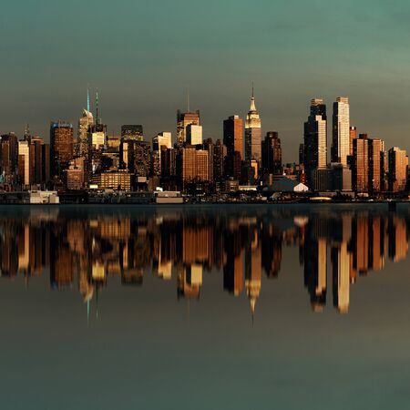 ny: Midtown Manhattan skyline with reflections at dusk panorama over Hudson River