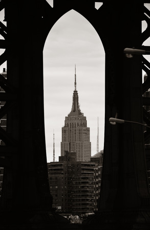 tallest bridge: NEW YORK CITY, NY - JUL 11: Empire State Building through Manhattan Bridge on July 11, 2014 in New York City. It is a 102-story landmark and was worlds tallest building for more than 40 years.