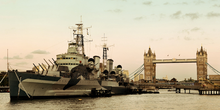 warship: HMS Belfast warship and Tower Bridge in Thames River in London