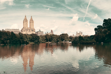 city park skyline: Central Park Spring with skyline panorama in midtown Manhattan New York City