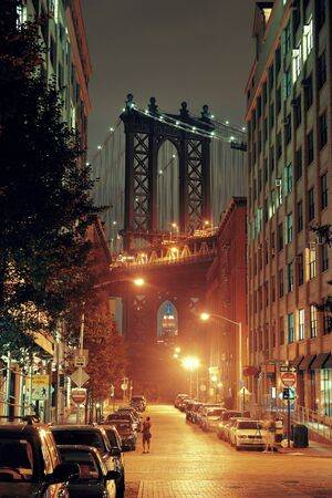 manhattan bridge: Manhattan Bridge viewed from street at night Editorial