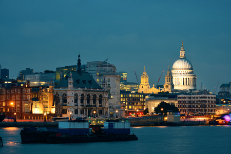 st pauls: St Pauls Cathedral over Thames River at night in London. Stock Photo