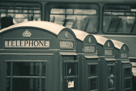 historical architecture: Telephone box in street with historical architecture in London in black and white.
