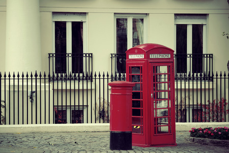 telephone: Red telephone booth and mail box in street in London as the famous icons.