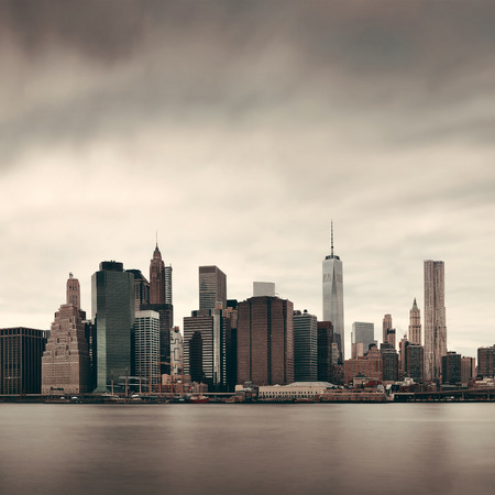 Manhattan financial district with skyscrapers over East River. Stock Photo