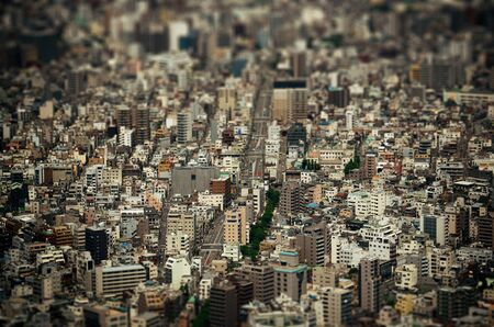 night shift: Tokyo urban rooftop view background tilt-shift effect, Japan.