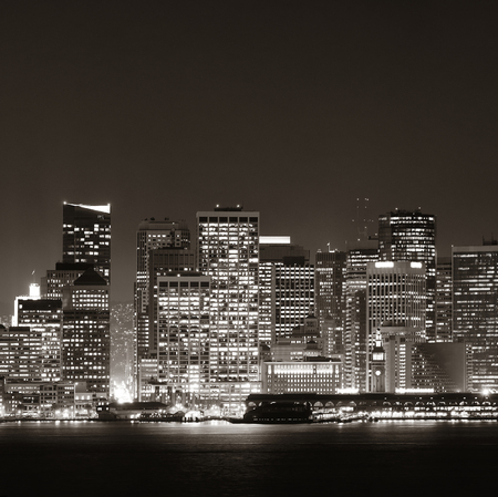 on the black sea: San Francisco city skyline with urban architectures at night in black and white.