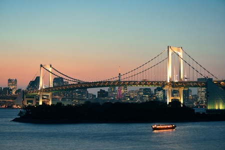 japan sunset: Tokyo bay with rainbow bridge and Tokyo Tower in Japan.