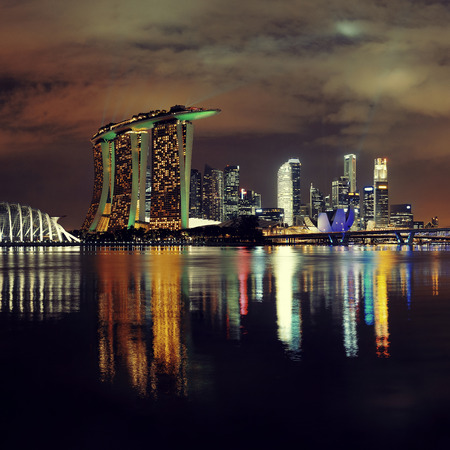 singapore city: Singapore skyline at night with urban buildings Editorial