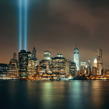 tribute: New York City downtown and september 11 tribute at night Stock Photo