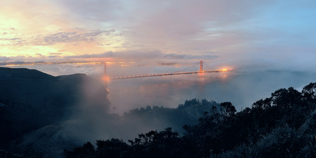 steel tower: Golden Gate Bridge and fog in San Francisco viewed from mountain top Stock Photo