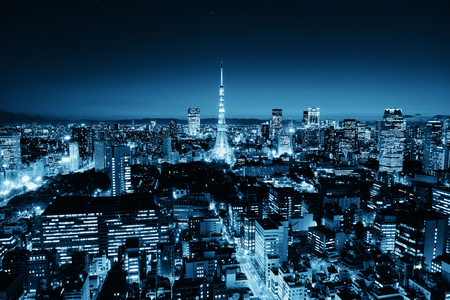 city night: Tokyo Tower and urban skyline rooftop view at night, Japan.