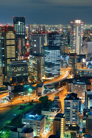 city night: Osaka urban city at night rooftop view. Japan.