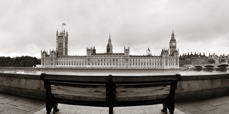westminster: Westminster panorama with chair at waterfront in London..