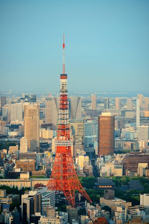 Tokyo Tower and urban skyline rooftop view at sunset, Japan. Editorial