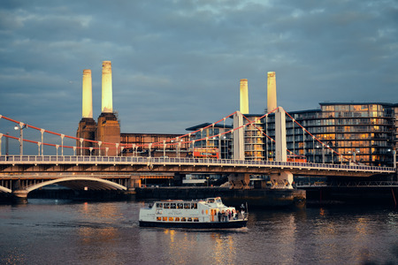 battersea: LONDON, UK - SEP 27: Battersea Power Station and bridge in Thames River on September 27, 2013 in London, UK. London is the worlds most visited city and the capital of UK. Editorial
