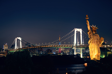 statue: Tokyo bay with rainbow bridge and Statue of Liberty in Japan.