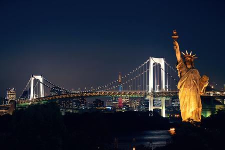 rainbow bridge: Tokyo bay with rainbow bridge and Statue of Liberty in Japan.