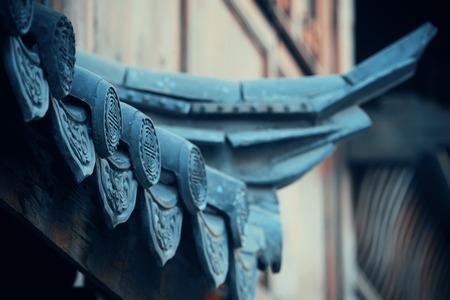 history building: Old roof closeup in Lijiang, Yunnan, China.